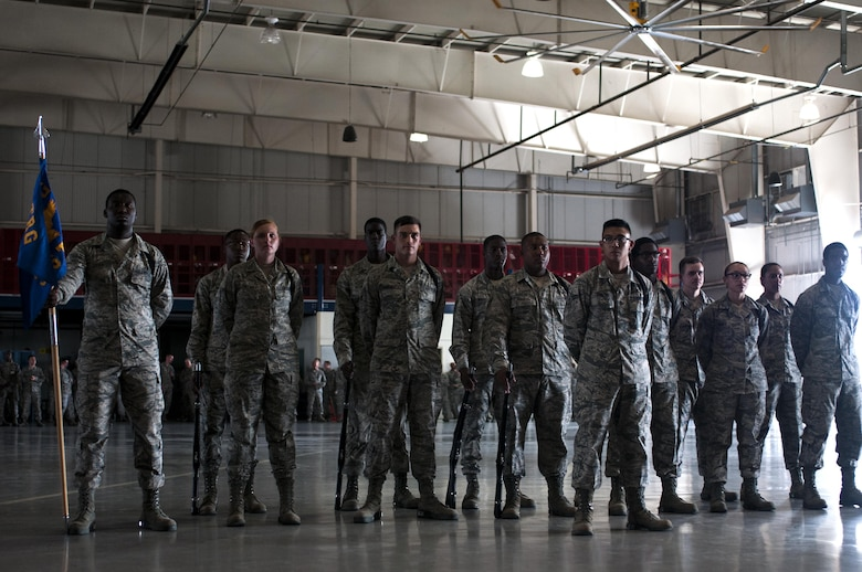 U.S. Air Force Airman of the 316th Training Squadron black rope corps stand in formation during a drill competition in the High Bay at the Louis F. Garland Fire Academy on Goodfellow Air Force Base, Texas, June 22, 2015. Goodfellow hosts the drill competitions quarterly. (U.S. Air Force photo by Senior Airman Scott Jackson/Released)