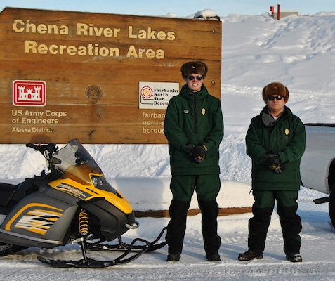 "Jacob Kresel (right), senior park ranger and natural resource specialist, and Cole Van Beusekom (left), park ranger, are easy to recognize with their forest green uniforms, ""Smokey bear"" hats and Corps castle belt buckles. The opportunity to work at the Chena Project in North Pole is a fulfilling vocation for both."