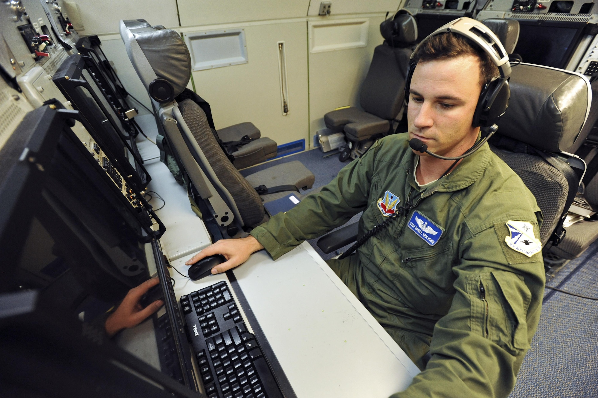 U.S. Air Force Staff Sgt. Daniel Van Horn, 966th Airborne Air Control Squadron, Oklahoma City, an airborne surveillance technician on an E-3G Airborne Warning and Control System aircraft, prepares for a mission above the Joint Pacific Alaska Range Complex during Exercise Northern Edge June 25, 2015. Thousands of service members from all the branch services including active duty, Reserve and National Guard units participated. (U.S. Air Force photo by Staff Sgt. William Banton/Released)