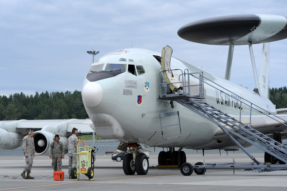 Maintenance crew members prepare a U.S. Air Force E-3G Airborne Warning and Control System aircraft for take off during Exercise Northern Edge June 25, 2015. Thousands of service members from all the branch services including active duty, Reserve and National Guard units participated. (U.S. Air Force photo by Staff Sgt. William Banton/Released)