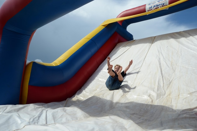 A child slides down a bouncy house during the Independence Day celebration, June 26, held at Marine Corps Logistics Base Albany.
