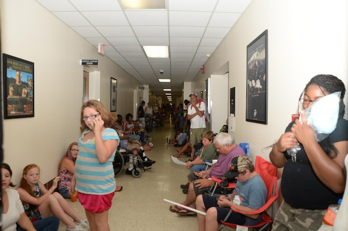 The halls of Building 3500 are filled with visitors from the community after base officials temporarily suspend the Independence Day celebration due to lightning.