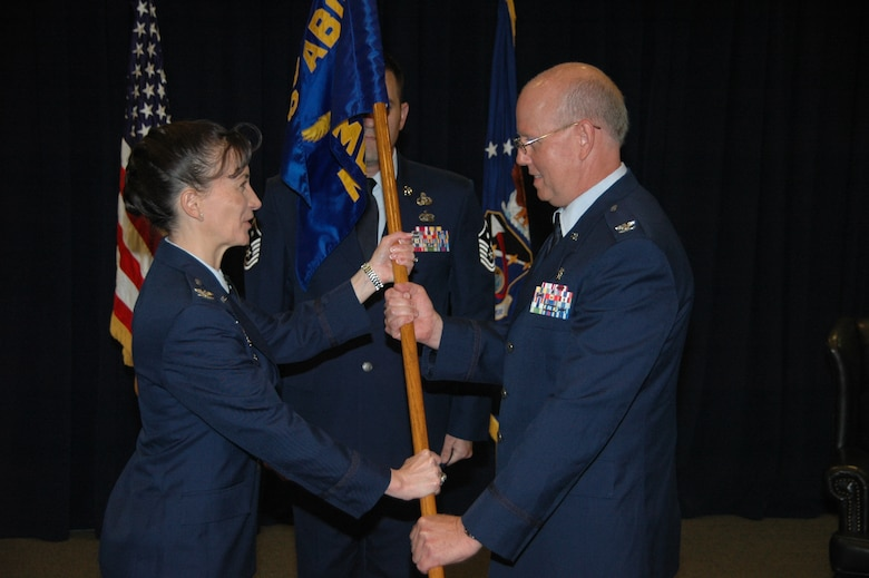 Col. (Dr.) Paul J. Hoerner accepts the 61st Medical Squadron ceremonial guidon from Col. Donna Turner, 61st Air Base Group commander during an assumption of command ceremony June 26 at the Gordon Conference Center. Hoerner becomes the newest commander of the 61st MDS, responsible for ensuring more than 1,200 active duty personnel assigned to the Space and Missile Systems Center at Los Angeles Air Force Base, are medically fit and ready for contingency (natural disasters and wartime) operations. He commands a staff of 178 active duty, government civilians and contract medical staff providing care for more than 171,000 eligible patients across the greater Los Angeles metropolitan area. (U.S. Air Force photo/Jim Spellman)