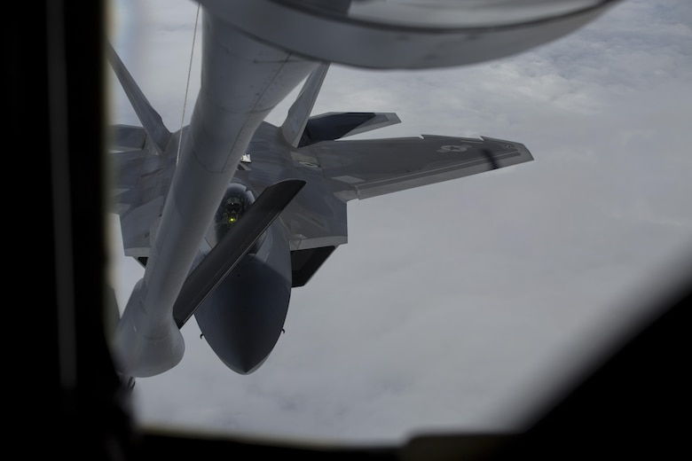 EIELSON AIR FORCE BASE, ALASKA – An F-22 Raptor prepares to refuel from a KC-135 Stratotanker from the 909th Air Refueling Squadron during Exercise Northern Edge, June 25, 2015. Northern Edge 2015 is Alaska's premier joint training exercise designed to practice operations, tactics, techniques and procedures as well as enhance interoperability among the services. Thousands of Airmen, Soldiers, Sailors, Marines and Coast Guardsmen from active duty, Reserve and National Guard units, including tankers from the 18th Air Refueling Wing out of Kadena Air Force Base, Okinawa, Japan, are involved. (U.S. Marine Corps photo by Cpl. Thor J. Larson/Released)