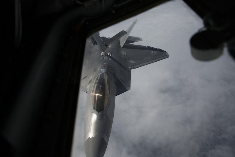 EIELSON AIR FORCE BASE, ALASKA – An F-22 Raptor refuels from a KC-135 Stratotanker from the 909th Air Refueling Squadron during Exercise Northern Edge, June 25, 2015. Northern Edge 2015 is Alaska's premier joint training exercise designed to practice operations, tactics, techniques and procedures as well as enhance interoperability among the services. Thousands of Airmen, Soldiers, Sailors, Marines and Coast Guardsmen from active duty, reserve and National Guard units, including tankers from the 18th Air Refueling Wing out of Kadena Air Force Base, Okinawa, Japan, are involved. (U.S. Marine Corps photo by Cpl. Thor J. Larson/Released)