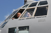 Honorary 2nd Lt. Trenton Bentley calls to family members out the window of a C-130 Hercules here, June 24, 2015. Trenton, who was diagnosed with acute lymphoblastic leukemia in December 2014, was nominated by Children's Hospital of Pittsburgh to be the 911th Airlift Wing's second ever Pilot for a Day. (U.S. Air Force photo by Staff Sgt. Allissa Landgraff)