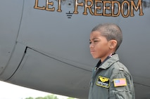 Honorary 2nd Lt. Trenton Bentley looks out at the flightline while standing next to a C-130 Hercules here, June 24, 2015. Trenton, who was diagnosed with acute lymphoblastic leukemia in December 2014, was nominated by Children's Hospital of Pittsburgh to be the 911th Airlift Wing's second ever Pilot for a Day. (U.S. Air Force photo by Senior Airman Marjorie A. Bowlden)