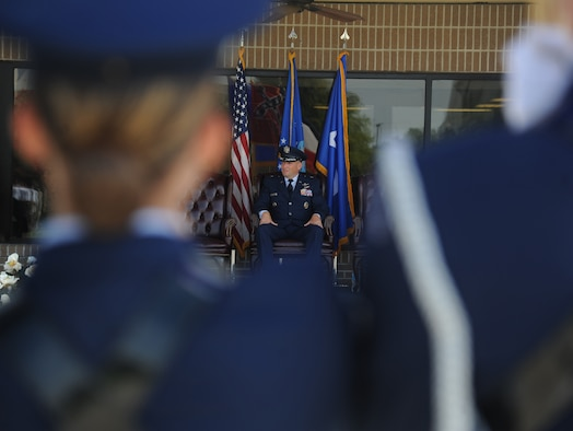 Brig. Gen. Patrick Higby, outgoing 81st Training Wing commander, listens as Col. Michele Edmondson gives her first speech as 81st TRW commander during a change of command, June 26, 2015, Keesler Air Force Base, Miss. Edmondson took command of the 81st TRW from Higby. (U.S. Air Force photo by Senior Airman Holly Mansfield)