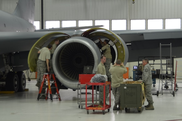Members of the 126th Maintenance Group replace an engine on a KC-135R Stratotanker at Scott AFB, Ill., Feb. 11, 2015. The 126th Air Refueling Wing, Illinois Air National Guard, flies the Stratotankers to refuel U.S. Armed Forces and NATO aircraft. (Air National Guard photo by Senior Airman Elise Stout)