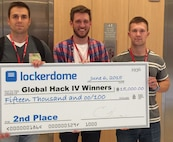"First Lt. Bradford Law, 38th Cyberspace Readiness Squadron, 1st Lt. Paul Jordan, Air Force Space Command, and teammate Chase Clettenberg (center), are awarded second place in GlobalHack IV June 7. Law and Jordan are two cyber Airmen who work to keep their skills sharp by melding their personal and professional interests, like participating in a local ""Hack-a-thon"" where competitors solved real-world problems by programming software. (Courtesy photo)"