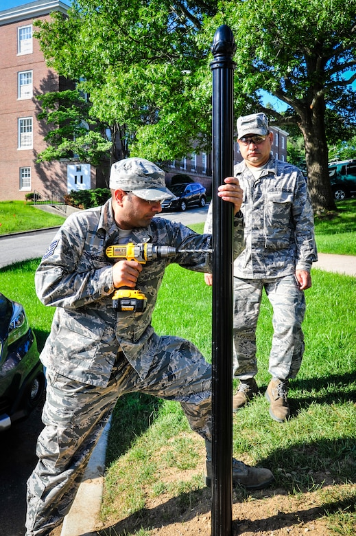 113th Civil Engineer Squadron Engineering Assistant Tech. Sgt. Gursimran Shergill and Operations Manager Master Sgt. Cruz Velez install new signposts while deployed for training to the U.S. Coast Guard Academy.  (U.S. Air National Guard photo by Chief Master Sgt. Andrew Baker)