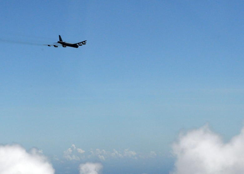 A B-52 Stratofortress from the 20th Expeditionary Bomb Squadron, flies over the Pacific Ocean June 26, 2015. Airmen from the 20th EBS dropped the final M117 bomb in the Pacific Air Force's inventory June 26 on an uninhabited island off the coast of Guam as part of a training mission to ensure the security and stability of the Indo-Asia Pacific region. (U.S. Air Force photo by Airman 1st Class Joshua Smoot/Released)