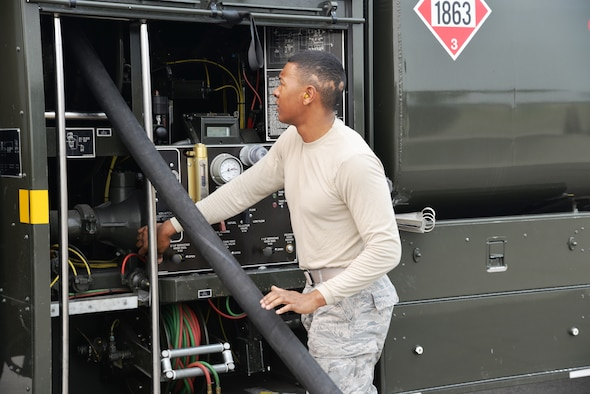 EIELSON AIR FORCE BASE, Alaska -- U.S. Air Force Airman 1st Class Anthony Jackson, a fuels management technician from the 18th Logistics Readiness Squadron, Kadena Air Base, Japan, turns the fuel pump off after re-fueling an F-15 Eagle June 23, 2015, at Eielson Air Force Base, Alaska. The fuel truck, an R-11, can hold approximately 6,000 gallons of fuel. Northern Edge 2015 is Alaska's premier joint training exercise designed to practice operations, techniques and procedures as well as enhance interoperability among the services. Thousands of participants from all the services, Airmen, Soldiers, Sailors, Marines and Coast Guardsmen from active duty, Reserve and National Guard units are involved. (U.S. Air Force photo by Staff Sgt. Kirsten Wicker/Released)