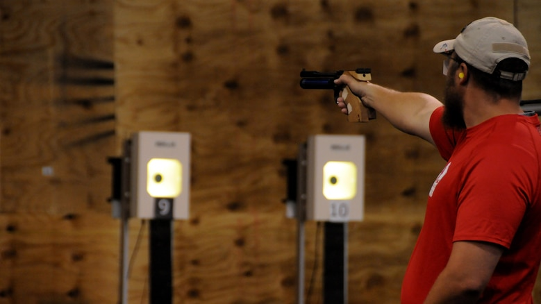 Medically retired Marine Clayton McDaniel shoots the air pistol in the shooting competition at the 2015 DoD Warrior Games at Marine Corps Base Quantico, Virginia, June 26, 2015. McDaniel earned a gold medal in the event.
