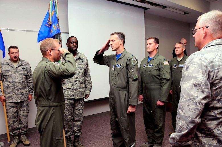 U.S. Air Force Col. Charles D. Davis III, commander of the 145th Operations Group, officiates over a change of command ceremony, as Lt. Col. Joseph H. Stepp IV relinquishes command of the 156th Airlift Squadron, June 6, 2015, at the North Carolina Air National Guard Base, Charlotte Douglas International Airport. (U.S. Air National Guard photo by Master Sgt. Patricia F. Moran, 145th Public Affairs/Released)