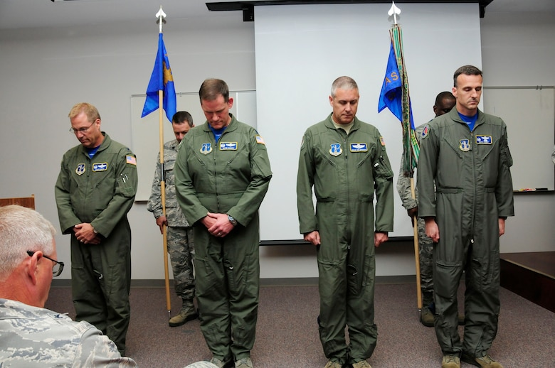 Leaders of the 145th Operations Group, bow their heads in prayer before a change of command ceremony  held at the North Carolina Air National Guard Base, Charlotte Douglas International Airport; June 6, 2015. (U.S. Air National Guard photo by Master Sgt. Patricia F. Moran, 145th Public Affairs/Released)