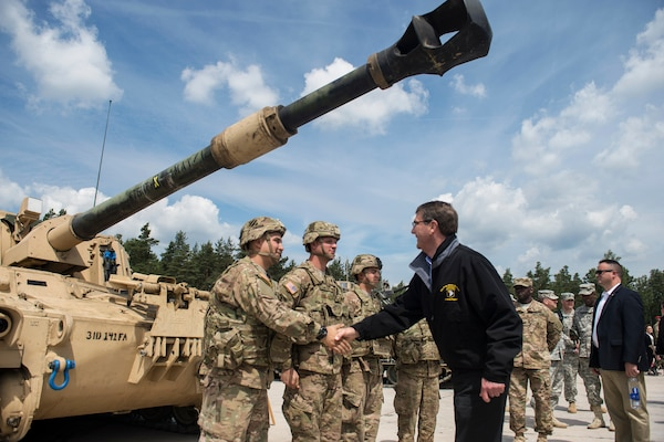 Defense Secretary Ash Carter shakes hands with crew members as he receives a tour of a static M109A6 self-propelled howitzer at the Grafenwoehr Training Area in Grafenwoehr, Germany, June 26, 2015. During his European trip, Carter also attended his first NATO defense ministers in Brussels as defense secretary. DoD photo by Air Force Master Sgt. Adrian Cadiz
