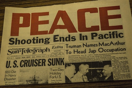 """A newspaper from the end of World War II with the headline """"Peace"""" in all capital letters lies on display at the Okinawa Prefectural Peace Memorial Museum in Itoman, Okinawa. A memorial service honoring the fallen men and women of the Battle of Okinawa was held on the 70th anniversary of the end of the battle June 23, at the Okinawa Peace Memorial Park. The ceremony had approximately 5,400 people in attendance from Okinawa and other prefectures. Honored guests included Prime Minister of Japan, Shinzo Abe; Governor of Okinawa Prefecture, Takeshi Onaga; U.S. Ambassador to Japan, Caroline Kennedy; U.S. Consul General, Alfred R. Magelby; Deputy Commanding General United States Forces Japan, Brig. Gen. Mark R. Wise; and Commanding General of Marine Corps Installations Pacific, Brig. Gen. Joaquin F. Malavet among others. During the ceremony there was a minute-long moment of silence at noon along with flowers brought to the front to honor the dead. Abe and Onaga also gave speaches expressing their grief and sorrow over the nearly 200,000 lives lost during the battle."""
