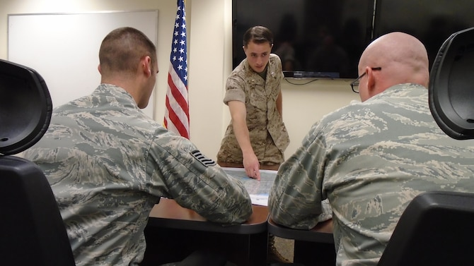 U.S. Marine Corps 1st Lt. Samuel Winsted, F-35B Lightning II intelligence officer, provides a mock intelligence briefing to two instructors during the F-35 Intelligence Formal Training Unit course, June 17, 2015, on Eglin Air Force Base, Florida. Winsted will serve in a critical role assisting the Marine Corps' F-35 program at Marine Corps Air Station Yuma, Arizona, as it becomes the first operational F-35B base. The Marine Corps will declare IOC with the F-35B, short take-off and vertical landing variant, this summer. (U.S. Air Force photo/Staff Sgt. Marleah Robertson)