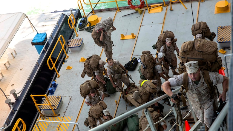 U.S. Marine Corps Sgt. Dylan Hudson, a squad leader with Company A, 1st Battalion, 4th Marine Regiment, Marine Rotational Force – Darwin, embarks on the USNS Sacagawea June 17, 2015 to depart Darwin, Northern Territory, Australia for Exercise Koa Moana 15.2 in East Timor. A platoon of Marines will be conducting a bilateral exercise with the East Timor Defence Force, focusing on individual-level fundamentals to build proficiency in complex squad and platoon level tasks. The bilateral training will include room clearing of buildings, urban movement and patrolling. The MRF-D six-month deployment demonstrates how the Marine Air Ground Task Force is equipped and organized to carry out national objectives in cooperation with our national and international partners. Hudson is a native of Seaford, Delaware.