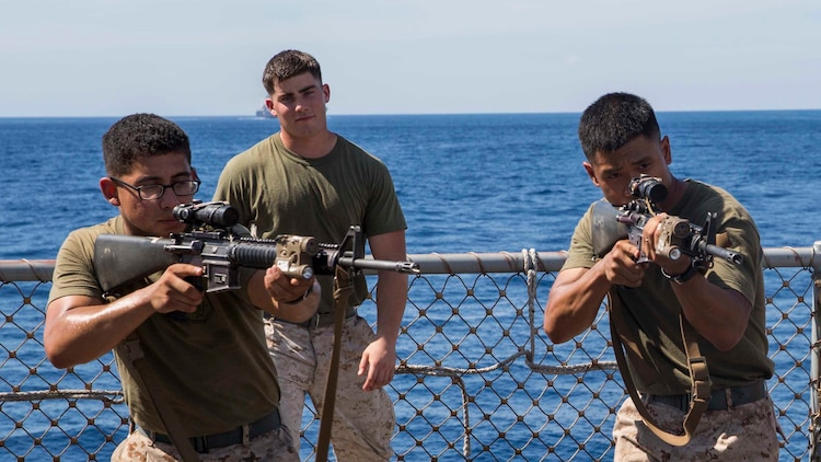 U.S. Marines with Company A, 1st Battalion, 4th Marine Regiment, Marine Rotational Force – Darwin, rehearse weapon presentation and four-man room clearing tactics and procedures aboard the USNS Sacagawea June 20, 2015 in Dili, East Timor in preparation for Exercise Koa Moana 15.2. The platoon of Marines will be conducting a bilateral exercise with the East Timor Defence Force, focusing on individual-level fundamentals to build proficiency in complex squad and platoon level tasks. The bilateral training will include room clearing of buildings, urban movement and patrolling. The MRF-D six-month deployment demonstrates how the Marine Air Ground Task Force is equipped and organized to carry out national objectives in cooperation with our national and international partners.