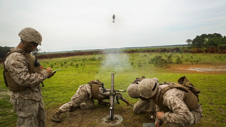 Marines with 2nd Battalion, 2nd Marine Regiment fire a 60mm mortar during a live-fire exercise aboard Camp Lejeune, N.C., June 25, 2015. The unit conducted the training to better prepare the Marines for the use of the direct lay method of fire. The direct lay method requires the Marines to make all their adjustments themselves and not rely on a Fire Direction Center. (U.S. Marine Corps photo by Cpl. Michael Dye/Released)