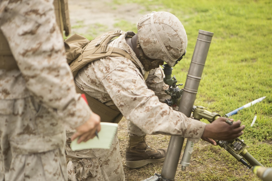 Marines with 2nd Battalion, 2nd Marine Regiment learn how to make adjustments on the 61mm mortar system at a live-fire range aboard Camp Lejeune, N.C., June 25, 2015.  The exercise allowed Marines new to the unit to gain knowledge and experience with both 61mm and 80 mm mortal systems. (U.S. Marine Corps photo by Cpl. Michael Dye/Released)