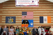 Capt. Timothy Irish gives a speech at the 2015 Sheepshead Bay High School graduation. Irish remarked on how being driven and well rounded will the new graduates successful at life. Irish is the public affairs officer with 1st Marine Corps District.