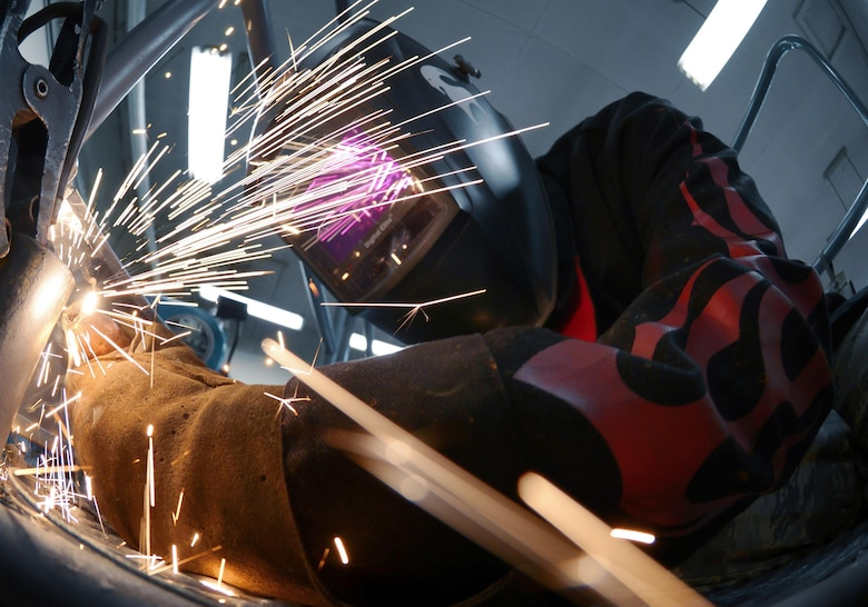 Airman 1st Class Curtis Doherty, a 374th Maintenance Squadron aircraft metals technology journeyman, welds a post hole for a B-1B Lancer platform at Yokota Air Base, Japan, June 23, 2015. The average time it takes to fix or create a piece of equipment is approximately eight hours. (U.S. Air Force photo/Senior Airman David Owsianka)