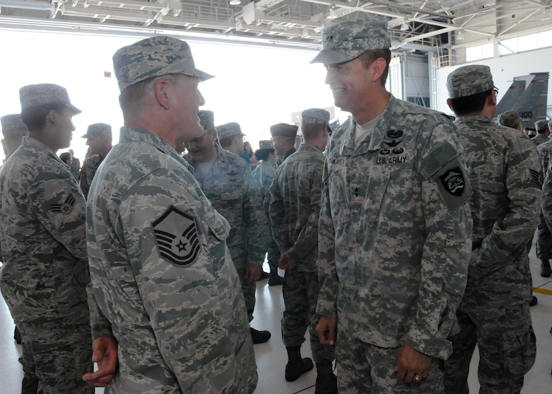 Army Maj. Gen. Daniel Hokanson, Adjutant General for Oregon, right, greets Airmen deploying in support of Operation Atlantic Resolve following the formal mobilization ceremony, June 26, 2015, Portland Air National Guard Base, Ore. (U.S. Air National Guard photo by Tech. Sgt. John Hughel, 142nd Fighter Wing Public Affairs/Released)