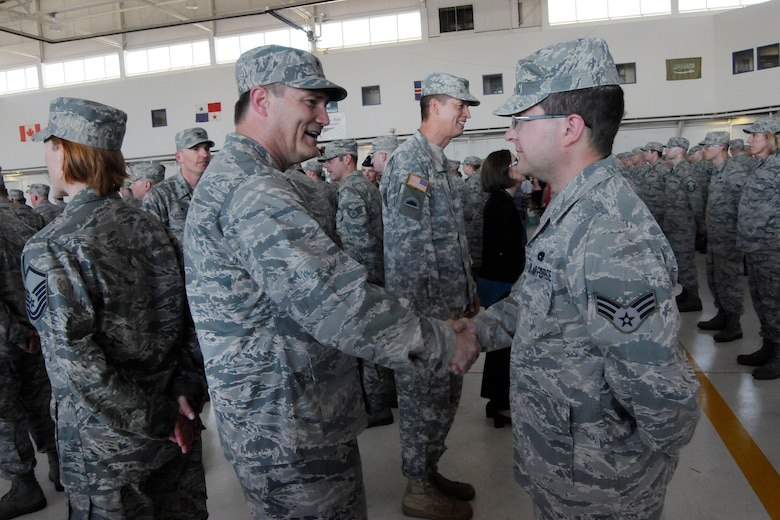 Air National Guard Brig. Gen. Michael Stencel, Oregon Air National Guard commander, left, greets Airmen deploying in support of Operation Atlantic Resolve, following the formal mobilization ceremony, June 26, 2015, Portland Air National Guard Base, Ore. (U.S. Air National Guard photo by Tech. Sgt. John Hughel, 142nd Fighter Wing Public Affairs/Released)