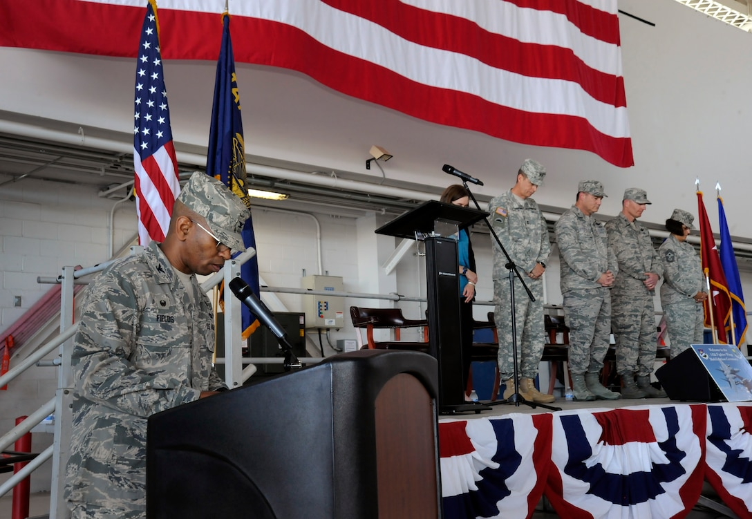 Oregon Air National Guard Col. Michael Fields, 142nd Fighter Wing Maintenance Group commander, delivers the invocation during the 142nd Fighter Wing mobilization ceremony, June 26, 2015, Portland Air National Guard Base, Ore. (U.S. Air National Guard photo by Tech. Sgt. John Hughel, 142nd Fighter Wing Public Affairs/Released)