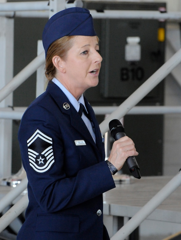 Oregon Air National Guard Senior Master Sgt. Denise Phillips, assigned to the 142nd Fighter Wing Mission Support Group, sings the National Anthem during the 142nd Fighter Wing mobilization ceremony, June 26, 2015, Portland Air National Guard Base, Ore. (U.S. Air National Guard photo by Tech. Sgt. John Hughel, 142nd Fighter Wing Public Affairs/Released)
