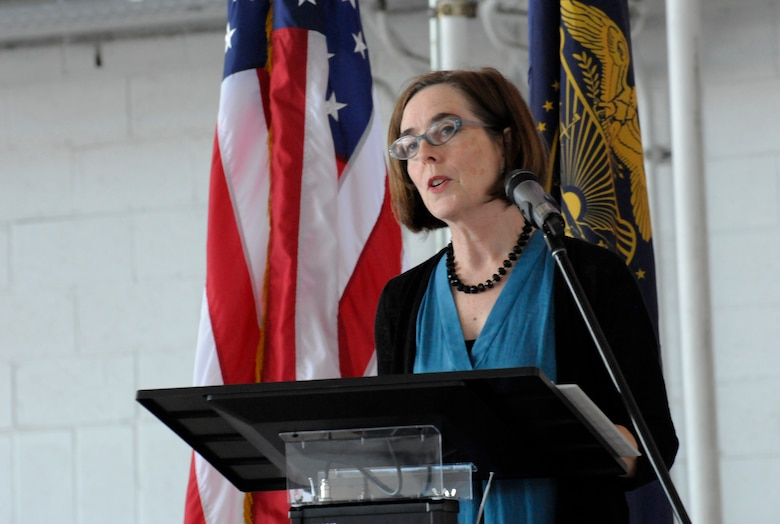 Oregon Governor Kate Brown addresses the Airmen, families and others in attendance at the 142nd Fighter Wing mobilization ceremony, June 26, 2015, Portland Air National Guard Base, Ore. The unit is deploying to Eastern Europe in support of Operation Atlantic Resolve.  (U.S. Air National Guard photo by Tech. Sgt. John Hughel, 142nd Fighter Wing Public Affairs/Released)