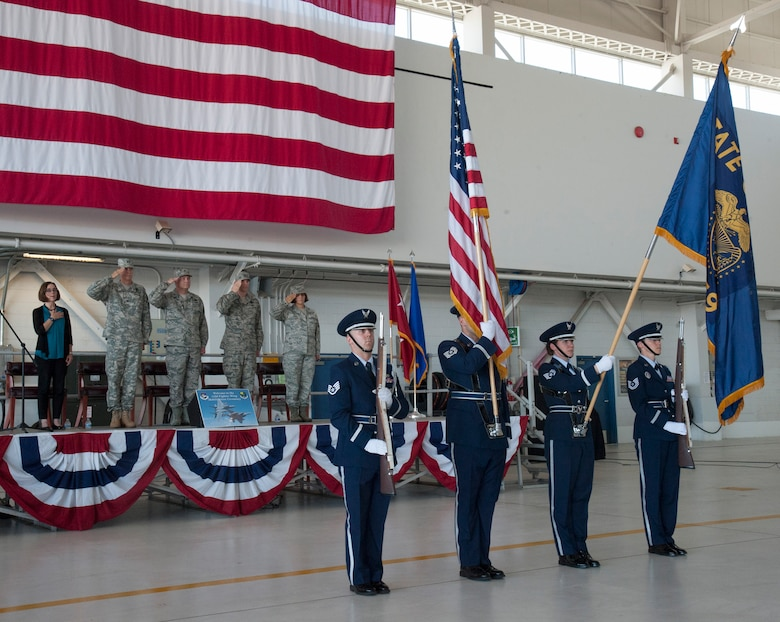 Members of the official party render honors to the colors of the American and State of Oregon flags presented by the 142nd Fighter Wing Base Honor Guard during the formal mobilization ceremony June 26, 2015, Portland Air National Guard Base, Ore. (U.S. Air National Guard photo by Tech. Sgt. John Hughel, 142nd Fighter Wing Public Affairs/Released)