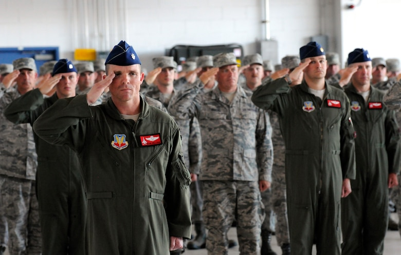 Oregon Air National Guard Lt. Col. Sean Sullivan, 123rd Fighter Squadron commander, 142nd Fighter Wing, left, along with other deploying Airmen, salutes the official party during the unit's mobilization ceremony, June 26, 2015, Portland Air National Guard Base, Ore. (U.S. Air National Guard photo by Tech. Sgt. John Hughel, 142nd Fighter Wing Public Affairs/Released)