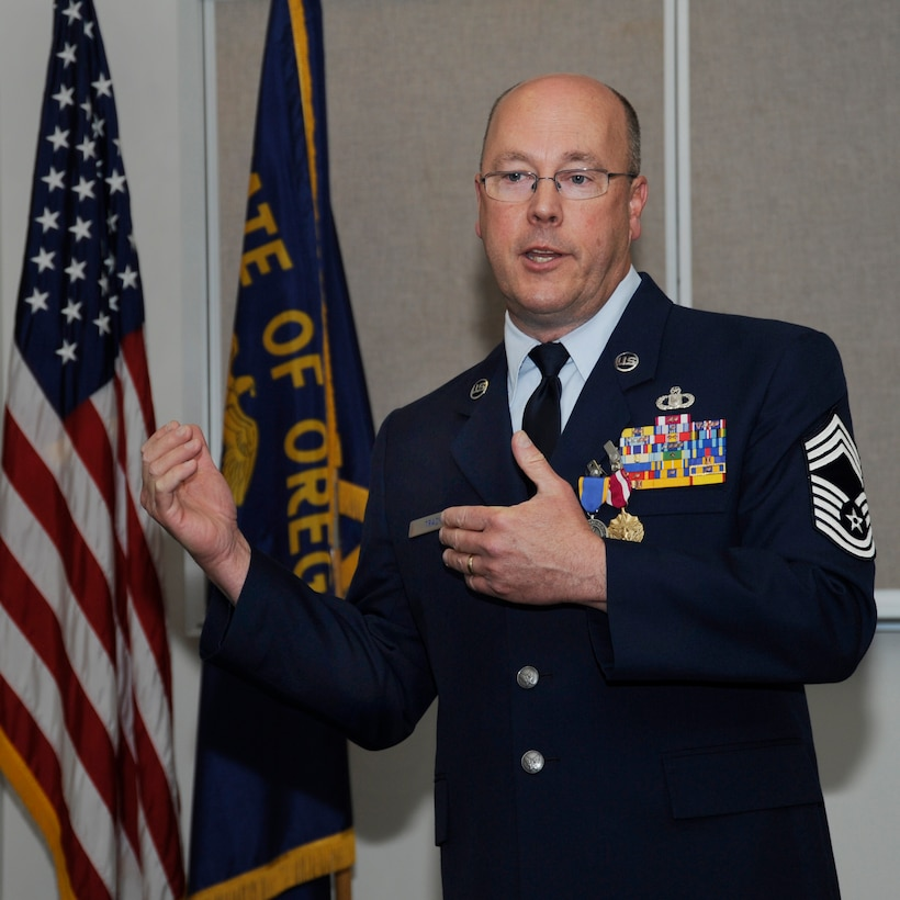 Oregon Air National Guard Chief Master Sgt. Patrick Tracy delivers his final remarks to those attending his formal retirement ceremony, May 2, 2015, Portland Air National Guard Base, Ore. Tracy was assigned to the 142nd Fighter Wing Operations Group, serving as the senior enlisted leader and also was the Team Chief for the Air National Guard's F-15 Eagle Weapons System Council, Aircrew Flight Equipment. (U.S. Air National Guard by Tech. Sgt. John Hughel, 142nd Fighter Wing Public Affairs Department)