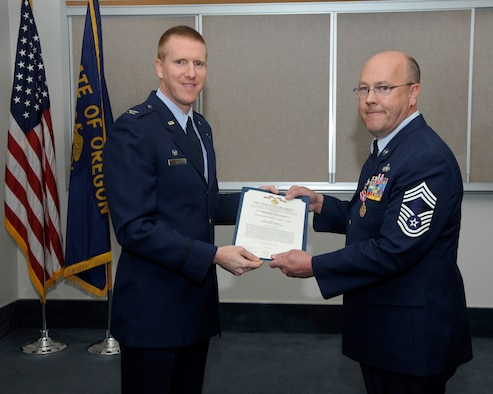 142nd Fighter Wing Operations Group Commander Col. Adam Sitler, left, present The Meritorious Service Medal to Chief Master Sgt. Patrick Tracy, 142nd Fighter Wing Operations Chief, right, during his retirement ceremony, May 2, 2015, Portland Air National Guard Base, Ore. Tracy was assigned to the 142nd Fighter Wing Operations Group, serving as the senior enlisted leader and also was the Team Chief for the Air National Guard's F-15 Eagle Weapons System Council, Aircrew Flight Equipment. (U.S. Air National Guard by Tech. Sgt. John Hughel, 142nd Fighter Wing Public Affairs Department)