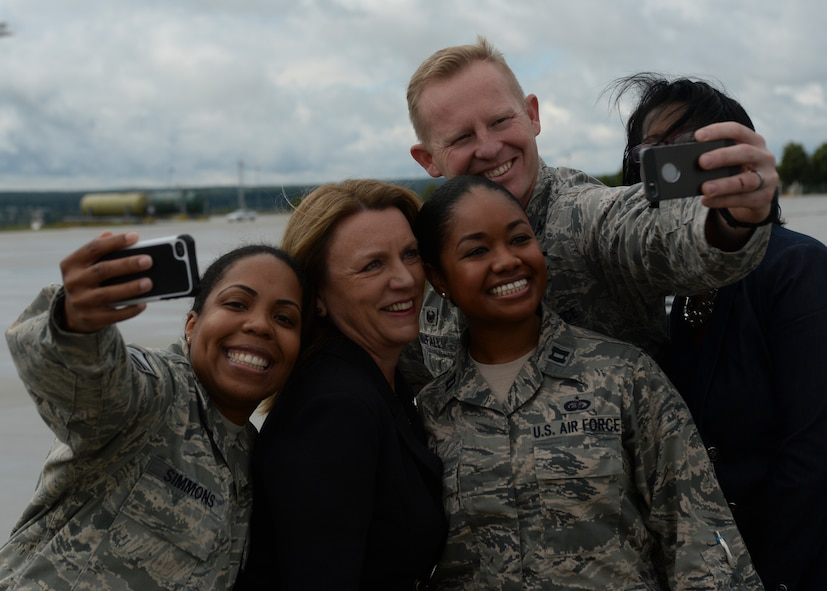 Deborah Lee James, Secretary of the U.S. Air Force, poses for a photo with U.S. Air Force Airmen assigned to the 52nd Fighter Wing during her visit of Spangdahlem Air Base, Germany, June 23, 2015. The Secretary completed a visit of installations through Europe June 24, 2015, to meet Airmen, community leaders and allied and partner nation defense chiefs. (U.S. Air Force photo by Staff Sgt. Joe W. McFadden/Released)