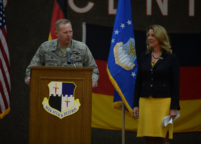 U.S. Air Force Col. Joe McFall, 52nd Fighter Wing commander, left, introduces Deborah Lee James, Secretary of the U.S. Air Force, during an all-call at the Skelton Memorial Fitness Center at Spangdahlem Air Base, Germany, June 23, 2015. The Secretary completed a visit of installations through Europe June 24, 2015, to meet Airmen, community leaders and allied and partner nation defense chiefs. (U.S. Air Force photo by Staff Sgt. Joe W. McFadden/Released)