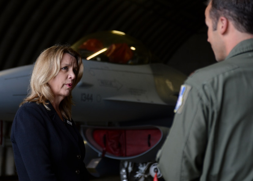 Deborah Lee James, Secretary of the U.S. Air Force, speaks with a U.S. Air Force major assigned to the 480th Fighter Squadron during her visit to the flightline at Spangdahlem Air Base, Germany, June 22, 2015. The Secretary completed a visit of installations through Europe June 24, 2015, to meet Airmen, community leaders and allied and partner nation defense chiefs. (U.S. Air Force photo by Staff Sgt. Joe W. McFadden/Released)