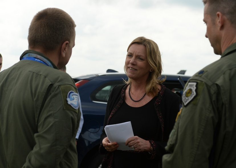 Deborah Lee James, Secretary of the U.S. Air Force, speaks Polish air force Brig. Gen. Darius Malinowski, 2nd Tactical Air Wing commander, during her visit to Lask Air Base, Poland, June 22, 2015. The Secretary completed a visit of installations through Europe June 24, 2015, to meet Airmen, community leaders and allied and partner nation defense chiefs. (U.S. Air Force photo by Staff Sgt. Joe W. McFadden/Released)