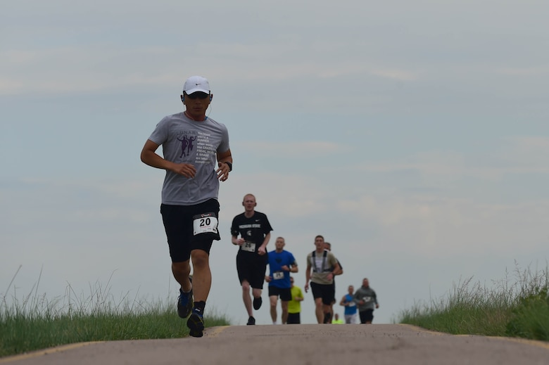 Team Buckley members run a 12k as part of the Dash to Distance series June 25, 2015, at Buckley Air Force Base, Colo. The Dash to Distance series started with a 5k and will gradually build up to a half- marathon run. Prizes were awarded to the top male and female finishers, along with Commander's Cup points. (U.S. Air Force photo by Airman 1st Class Luke W. Nowakowski/Released)