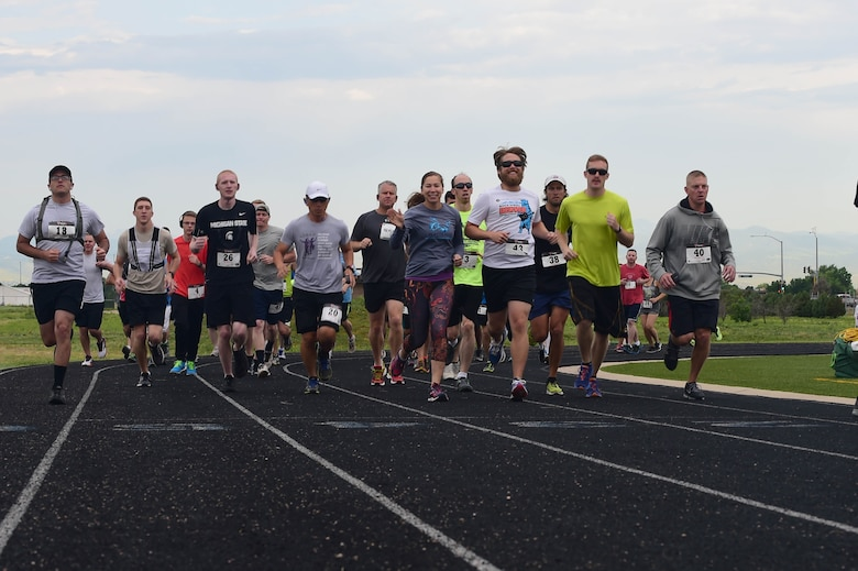 Team Buckley members embark on a 12k run as part of the Dash to Distance series June 25, 2015, at the all-purpose field on Buckley Air Force Base, Colo. The Dash to Distance series started with a 5k and will gradually build up to a half-marathon run. Prizes were awarded to the top male and female finishers, along with Commander's Cup points. (U.S. Air Force photo by Airman 1st Class Luke W. Nowakowski/Released)