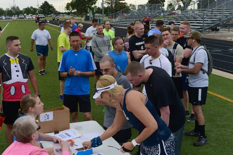 Team Buckley members sign in for the Dash to Distance 12k June 25, 2015, at the all-purpose field on Buckley Air Force Base, Colo. The Dash to Distance series started with a 5k and will gradually build up to a half-marathon run. Prizes were awarded to the top male and female finishers, along with Commander's Cup points. (U.S. Air Force photo by Airman 1st Class Luke W. Nowakowski/Released)