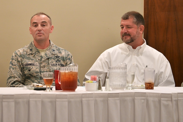 """U.S. Air Force Col. Robert Coxwell, 557th Weather Wing vice commander, speaks to a gathering inside the Patriot Club during a diversity luncheon at Offutt Air Force Base, Nebraska June 24. Coxwell discussed some of the challenges he and his spouse, Tom, experienced as a same-sex couple before the repeal of the Defense of Marriage Act and the """"Don't ask, don't tell"""" policy. (U.S. Air Force Photo by Charles Haymond/Released)"""