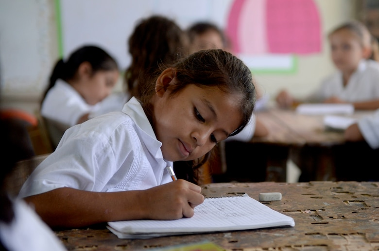 A Gabriela Mistral third grader practices math problems at the Gabriela Mistral School in Ocotes Alto, Honduras, June 16, 2015. Gabriela Mistral is the site of a new two-room classroom being built by U.S. Air Force Airmen from the 823rd Expeditionary RED HORSE Squadron, and U.S. Marines from the 271st Marine Wing Support Squadron, 2nd Marine Air Wing, as part of the NEW HORIZONS Honduras 2015 training exercise going on throughout the Trujillo and Tocoa, Honduras regions. NEW HORIZONS was launched in the 1980s and is an annual joint humanitarian assistance exercise conducted by U.S. Southern Command with a partner nation in Central America, South America or the Caribbean. The exercise improves joint training readiness of U.S. and partner nation civil engineers, medical professionals and support personnel through humanitarian assistance activities. (U.S. Air Force photo by Capt. David J. Murphy/Released)