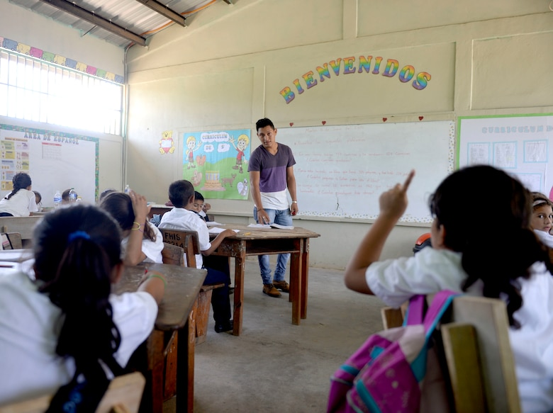Cristian Suazo teaches Gabriela Mistral third grade math at the Gabriela Mistral School in Ocotes Alto, Honduras, June 16, 2015. Gabriela Mistral is the site of a new two-room classroom being built by U.S. Air Force Airmen from the 823rd Expeditionary RED HORSE Squadron, and U.S. Marines from the 271st Marine Wing Support Squadron, 2nd Marine Air Wing, as part of the NEW HORIZONS Honduras 2015 training exercise going on throughout the Trujillo and Tocoa, Honduras regions. NEW HORIZONS was launched in the 1980s and is an annual joint humanitarian assistance exercise conducted by U.S. Southern Command with a partner nation in Central America, South America or the Caribbean. The exercise improves joint training readiness of U.S. and partner nation civil engineers, medical professionals and support personnel through humanitarian assistance activities. (U.S. Air Force photo by Capt. David J. Murphy/Released)