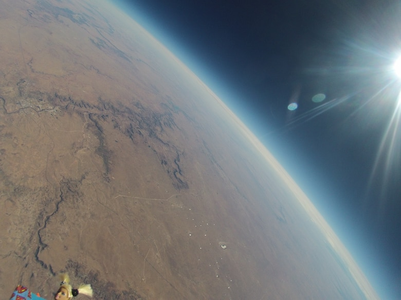 An image of the earth taken by the high-altitude helium balloon launched recently by Albuquerque Public School District and Valley High School's AF JROTC unit. The cadets sent a doll, lower left, along for the ride. (Contributed/Cleared)