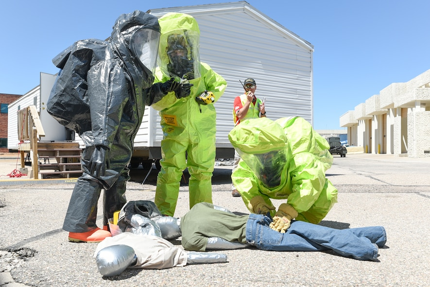 U.S. Air Force Staff Sgt. Farooq Durrani, 153rd Bioenvironmental Engineering, Senior Airman Collin Holte, 153rd Emergency Management, and Brent Osborne, Cheyenne Region 7 Hazmat, tend to simulated chlorine contaminated victims, June 19, 2015, at Cheyenne Air National Guard Base in Cheyenne, Wyo. Durrani, Holte, and Osborne are participating in Counter-CBRN All-Hazard Management Response (CAMR) training with civilian and military first responders to practice chemical, biological, radiological, first response, medical, and incident command scenarios for possible threats in the region. (U.S. Air National Guard photo by Master Sgt. Charles Delano)